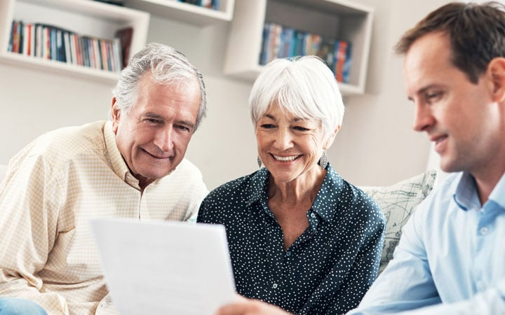 Older Couple Viewing Documents in Office | SpringwoodsBehavioral.com